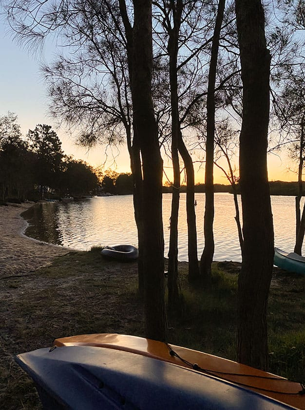 Gallery-Portrait-Sunset-through-trees-with-kayaks